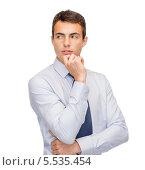 Купить «Задумавшийся бизнесмен», фото № 5535454, снято 12 сентября 2013 г. (c) Syda Productions / Фотобанк Лори
