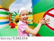 Купить «Весёлая девочка на надувном детском аттракционе», фото № 5543014, снято 23 июня 2012 г. (c) Losevsky Pavel / Фотобанк Лори