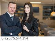 Купить «Деловые мужчина и женщина в офисе», фото № 5544314, снято 14 февраля 2013 г. (c) Losevsky Pavel / Фотобанк Лори