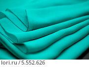 Купить «Зелёная ткань со складками», фото № 5552626, снято 14 августа 2013 г. (c) Morgenstjerne / Фотобанк Лори