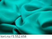 Купить «Складки зелёной ткани», фото № 5552658, снято 14 августа 2013 г. (c) Morgenstjerne / Фотобанк Лори