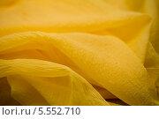 Купить «Желтая ткань», фото № 5552710, снято 14 августа 2013 г. (c) Morgenstjerne / Фотобанк Лори