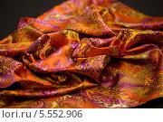Купить «Оранжевая ткань с яркими цветными рисунками», фото № 5552906, снято 14 августа 2013 г. (c) Morgenstjerne / Фотобанк Лори