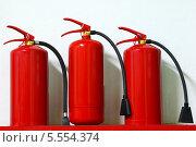 Купить «Огнетушители», фото № 5554374, снято 28 апреля 2013 г. (c) yeti / Фотобанк Лори