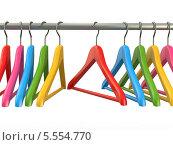 Купить «Разноцветные вешалки на перекладине», иллюстрация № 5554770 (c) Maksym Yemelyanov / Фотобанк Лори