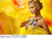 Купить «Красивая молодая блондинка в пестром платье среди больших желтых цветов», фото № 5571390, снято 2 февраля 2013 г. (c) Andrejs Pidjass / Фотобанк Лори