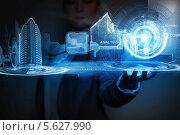 Купить «3D-модель современного города на ладони бизнесмена. Инновации и новые технологии», фото № 5627990, снято 16 сентября 2012 г. (c) Sergey Nivens / Фотобанк Лори