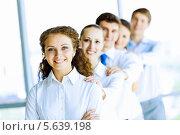 Купить «Команда успешных деловых людей в офисе», фото № 5639198, снято 21 июня 2013 г. (c) Sergey Nivens / Фотобанк Лори
