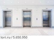 Купить «Три двери в лифты», фото № 5650950, снято 8 декабря 2010 г. (c) Losevsky Pavel / Фотобанк Лори