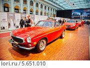 Купить «Красные машины Volvo P1800, SUV XC60 and S60 в Гостином дворе на Volvo Fashion Week, Москва», фото № 5651010, снято 4 апреля 2012 г. (c) Losevsky Pavel / Фотобанк Лори
