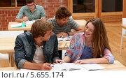 Купить «Students sitting in classroom studying», видеоролик № 5655174, снято 16 января 2018 г. (c) Wavebreak Media / Фотобанк Лори
