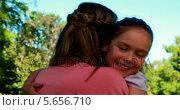 Купить «Cute daughter running to her mothers arms», видеоролик № 5656710, снято 20 января 2018 г. (c) Wavebreak Media / Фотобанк Лори