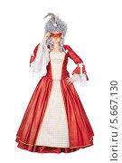 Купить «Женщина в красном платье с карнавальной маской», фото № 5667130, снято 13 декабря 2013 г. (c) Сергей Сухоруков / Фотобанк Лори