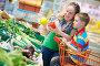 Женщина с сыном покупают овощи в супермаркете, фото № 5680162, снято 10 июня 2013 г. (c) Дмитрий Калиновский / Фотобанк Лори