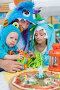 Отец с дочерью и сыном в костюмах монстров празднуют день рождения в кафе, фото № 5693274, снято 16 августа 2013 г. (c) Losevsky Pavel / Фотобанк Лори