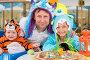 Отец с дочерью в костюмах монстров и мальчик в костюме тигра празднуют день рождения в кафе, фото № 5693290, снято 16 августа 2013 г. (c) Losevsky Pavel / Фотобанк Лори