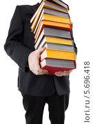 Купить «Мужчина держит в руках стопку книг», фото № 5696418, снято 11 марта 2014 г. (c) Александр Калугин / Фотобанк Лори