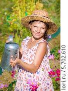 Купить «Девочка с лейкой на дачном участке», фото № 5702610, снято 13 августа 2013 г. (c) Papoyan Irina / Фотобанк Лори