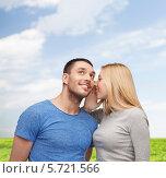 Купить «Девушка что-то говорит своему другу по секрету», фото № 5721566, снято 9 февраля 2014 г. (c) Syda Productions / Фотобанк Лори
