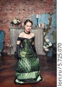 Купить «Красивая девушка в старинном платье делает реверанс», фото № 5725070, снято 27 февраля 2014 г. (c) Darkbird77 / Фотобанк Лори