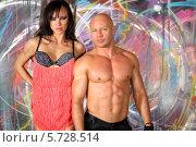 Купить «Лысый мускулистый мужчина и женщина в белье с пайетками в студии», фото № 5728514, снято 11 мая 2013 г. (c) Losevsky Pavel / Фотобанк Лори