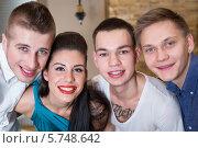 Купить «Портрет трех молодых ребят и веселой девушки», фото № 5748642, снято 25 декабря 2012 г. (c) Losevsky Pavel / Фотобанк Лори