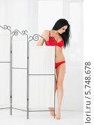 Купить «Красивая молодая девушка в красном нижнем белье», фото № 5748678, снято 12 апреля 2013 г. (c) Losevsky Pavel / Фотобанк Лори