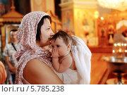 Купить «Крещение младенцев», фото № 5785238, снято 26 мая 2013 г. (c) Olena Vlasko / Фотобанк Лори