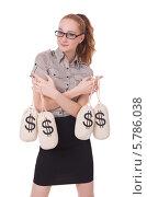 Купить «Деловая девушка держит мешки с деньгами», фото № 5786038, снято 9 ноября 2013 г. (c) Elnur / Фотобанк Лори