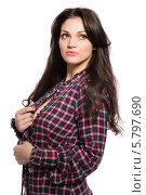 Купить «Красивая длинноволосая брюнетка в клетчатой блузке», фото № 5797690, снято 5 марта 2014 г. (c) Сергей Сухоруков / Фотобанк Лори