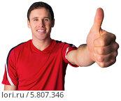Football fan in red showing thumbs up. Стоковое фото, агентство Wavebreak Media / Фотобанк Лори