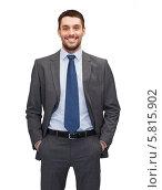 Купить «Позитивный бизнесмен в застегнутом пиджаке стоит, засунув руки в карманы брюк», фото № 5815902, снято 15 марта 2014 г. (c) Syda Productions / Фотобанк Лори