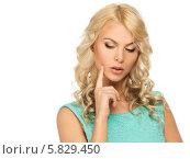 Купить «Портрет задумчивой молодой женщины с длинными светлыми волосами на белом фоне», фото № 5829450, снято 15 апреля 2014 г. (c) Andrejs Pidjass / Фотобанк Лори
