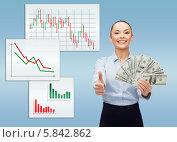 Купить «Позитивная деловая женщина в блузке стоит держит в руках много долларовых купюр», фото № 5842862, снято 8 декабря 2013 г. (c) Syda Productions / Фотобанк Лори