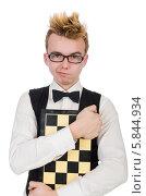 Купить «Забавный молодой человек в очках с шахматной доской», фото № 5844934, снято 5 февраля 2014 г. (c) Elnur / Фотобанк Лори