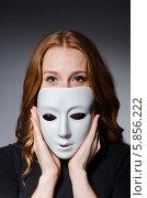 Купить «Рыжеволосая девушка скрывает лицо под белой маской», фото № 5856222, снято 20 октября 2013 г. (c) Elnur / Фотобанк Лори
