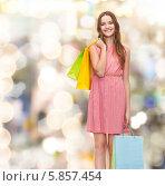 Купить «Девушка в хорошем настроение после похода по магазинам», фото № 5857454, снято 26 февраля 2014 г. (c) Syda Productions / Фотобанк Лори