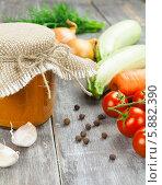 Купить «Кабачковая икра и ингредиенты для ее приготовления на деревянном столе», фото № 5882390, снято 7 мая 2014 г. (c) Надежда Мишкова / Фотобанк Лори