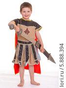 Купить «Маленький мальчик в костюме рыцаря вынимает меч из ножен, изолированно на белом фоне», фото № 5888394, снято 3 мая 2014 г. (c) Сергей Колесников / Фотобанк Лори