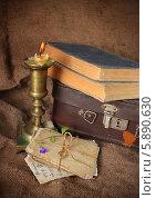 Купить «Старые фотографии, книги и медный подсвечник», фото № 5890630, снято 10 мая 2014 г. (c) Наталья Осипова / Фотобанк Лори