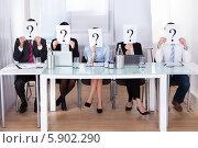 Купить «деловые люди держат знак вопроса перед лицами», фото № 5902290, снято 15 декабря 2013 г. (c) Андрей Попов / Фотобанк Лори