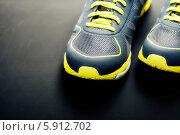 Купить «Спортивная обувь, кроссовки на темном фоне», фото № 5912702, снято 1 апреля 2014 г. (c) Наталия Кленова / Фотобанк Лори