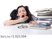 Купить «Уставшая студентка зевает около книг», фото № 5923994, снято 31 мая 2012 г. (c) Elnur / Фотобанк Лори