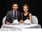 Купить «Молодая красивая пара за столиком в модном ресторане», фото № 5937770, снято 9 марта 2014 г. (c) Syda Productions / Фотобанк Лори