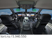 Купить «Кабина современного пассажирского авиалайнера. Автопилот, голубое небо за окном», фото № 5940550, снято 29 августа 2013 г. (c) Игорь Долгов / Фотобанк Лори