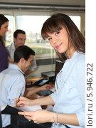 Купить «красивая молодая женщина работает в офисе», фото № 5946722, снято 13 февраля 2010 г. (c) Phovoir Images / Фотобанк Лори