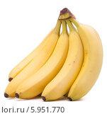 Купить «Связка свежих бананов на белом фоне», фото № 5951770, снято 22 марта 2013 г. (c) Natalja Stotika / Фотобанк Лори