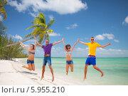 Купить «Жизнерадостные друзья прыгают на песчаном пляже экзотического острова», фото № 5955210, снято 31 августа 2013 г. (c) Syda Productions / Фотобанк Лори