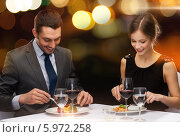 Купить «Праздничный ужин в ресторане. Мужчина и женщина сидят за столиком», фото № 5972258, снято 9 марта 2014 г. (c) Syda Productions / Фотобанк Лори