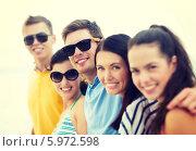 Купить «Радостные друзья с удовольствием позирут, стоя рядом друг с другом», фото № 5972598, снято 31 августа 2013 г. (c) Syda Productions / Фотобанк Лори